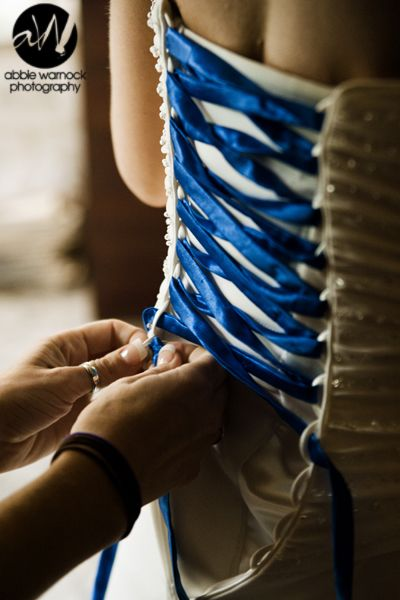 "Wedding Details - ideas - Dress - Colors - Royal Blue - Want to bring ""something blue"" into what you're wearing without having to choose underwear?  This bride chose to lace up with a blue ribbon instead of the typical white.  Photography by Abbie Warnock"