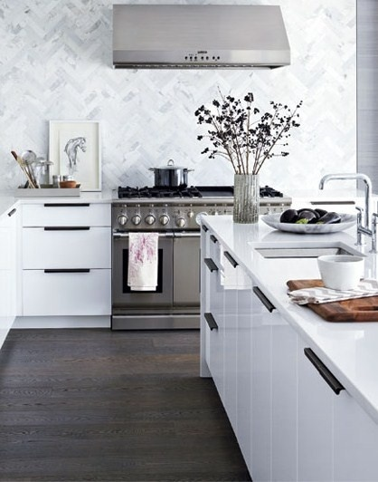 The Designer Lifestyle: Marble backsplash in a herringbone pattern