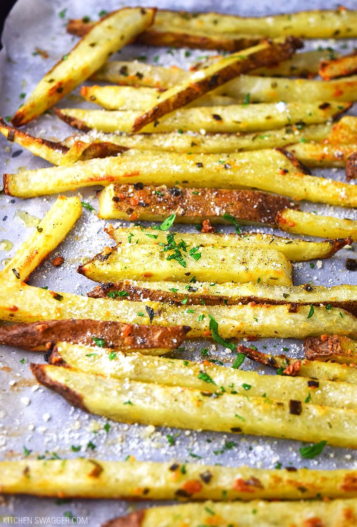 Crispy, golden baked parmesan truffle fries seasoned with truffle oil, garlic powder, parsley, and grated parmesan cheese.