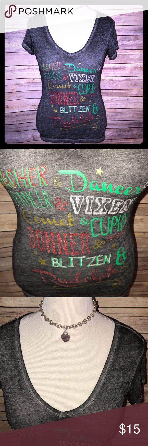 Glittery Festive Holiday V Neck Tee On Dasher and Dancer and Prancer and Vixen! Super cute and festive holiday tee with all of your favorite reindeer names in sparkly Christmas colors. Very stretchy and soft in distressed charcoal shade (not see through). Excellent quality and condition. Check out my other listings to bundle and save! Rocker Girl Tops Tees - Short Sleeve