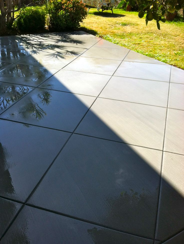 Concrete patio with diamond pattern.