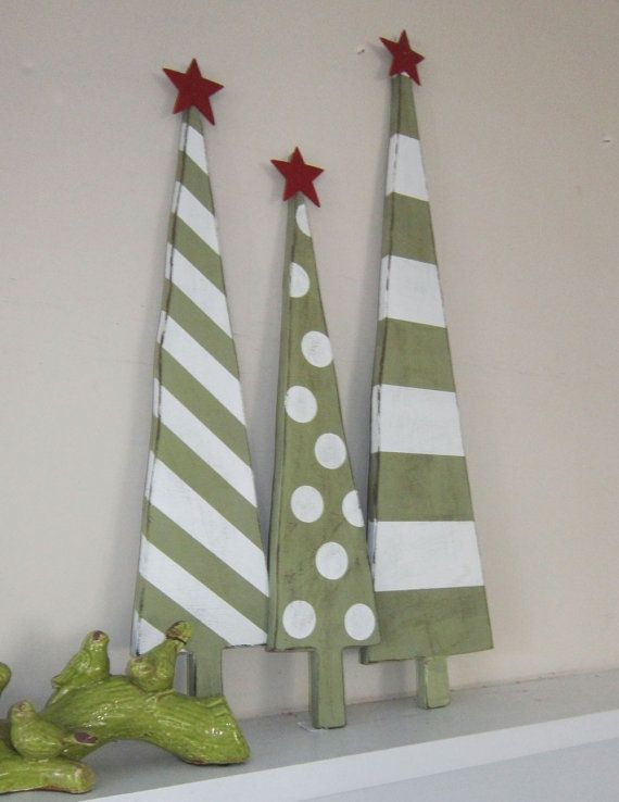 I pinned these xmas trees although the link does not show up. I thought the picture might be enough. I think they're cut from wood but it looks like a seam or something on the left. Maybe fabric and then painted.?: