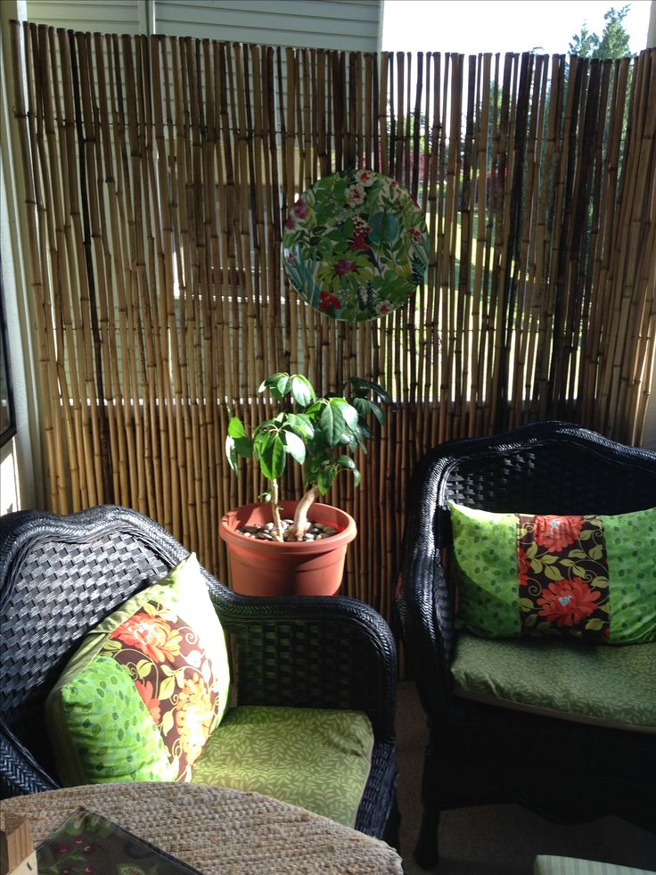 Easy makeover using bamboo fencing for privacy, spray paint on chairs and little sewing. Results...cozy condo balcony!                                                                                                                                                      More