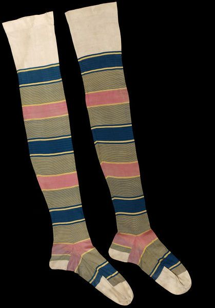1860s Women's knitted silk stockings in stripes of blue, green and pink, white top and toe. The V&A, London.