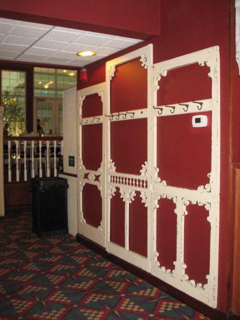 Coat hook area, Old screen doors side by side