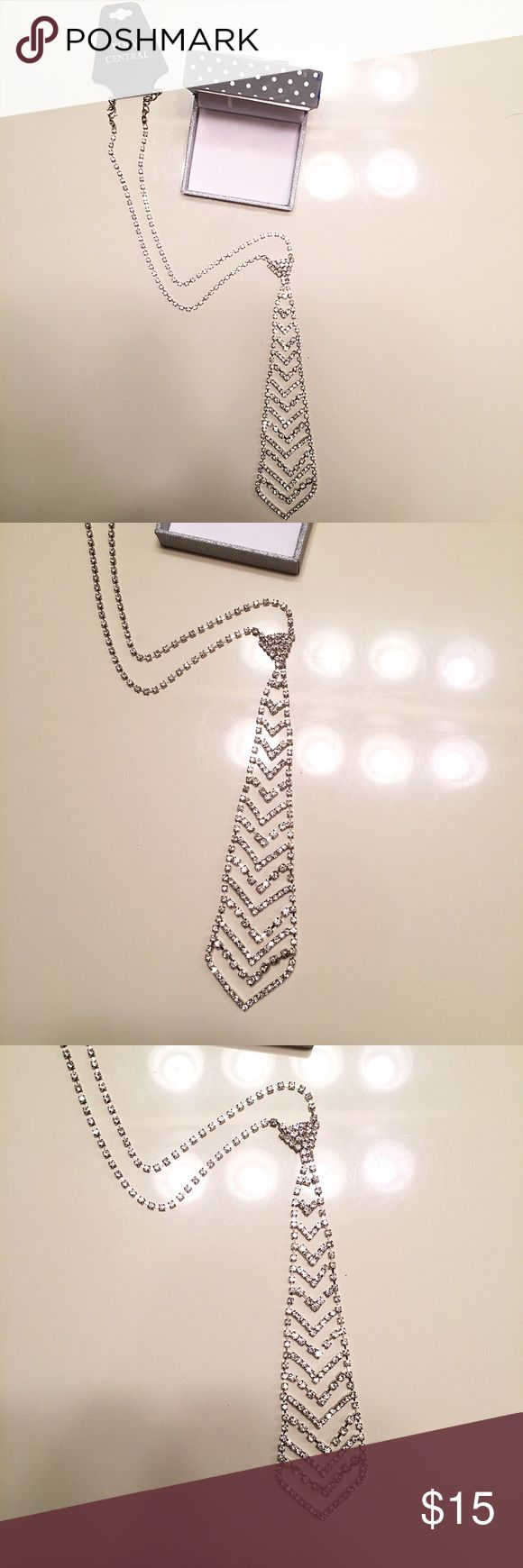 NEW Body Central rhinestone tie neckless Brand new, never worn and still with tags. Body Central rhinestone tie neckless. Body Central was my favorite store... why did they close down!? 🙁 this neckless would be perfect to surprise your man with (just imagine wearing nothing but this😏 lol) Body Central Jewelry Necklaces