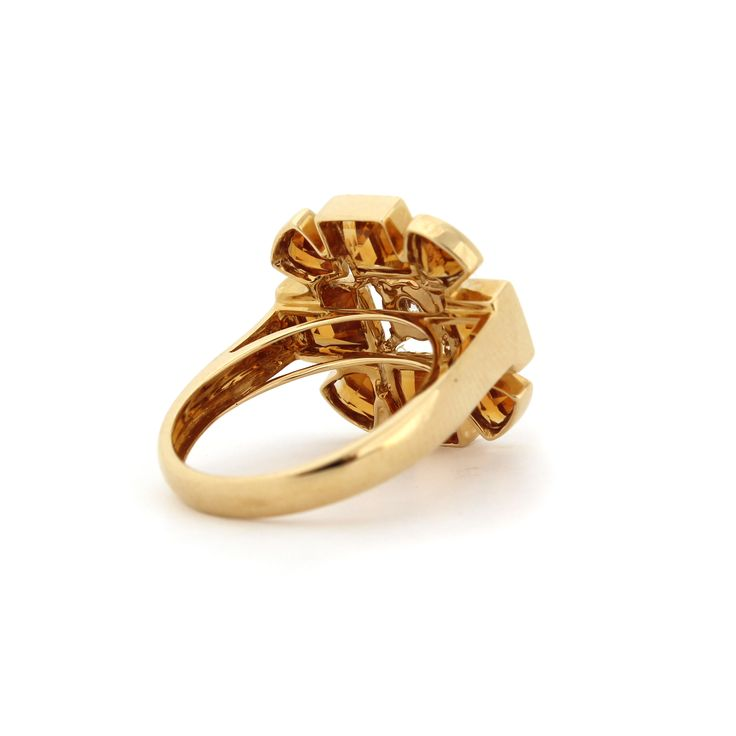 SACRED FLOWER RING   The ring is made from 18kt yellow gold diamonds and citrine.   Citrine is a beautiful honey coloured golden gemstone that complements all skin tones. The 18kt gold compliments citrine beautifully.