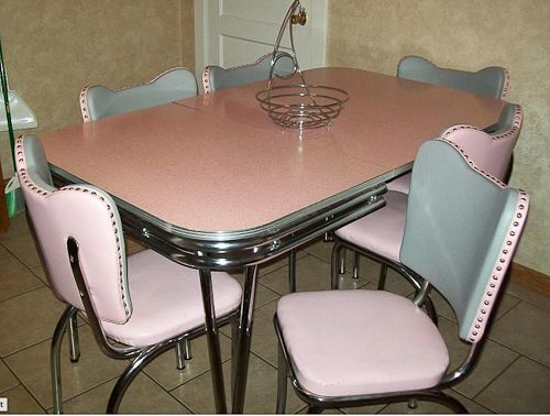 When I was upstate NY this summer I saw this 1950's table and chair set. The one I saw was black and silver with glitter...wish my tiny NY kitchen was bigger...it so would have been mine. I dig this pink one too!