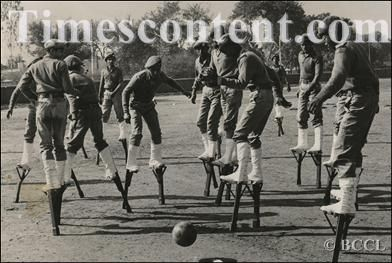 National Cadet Corps (NCC) cadets on stilts playing football at the Republic Day Camp held in New Delhi on Januray 11, 1982.