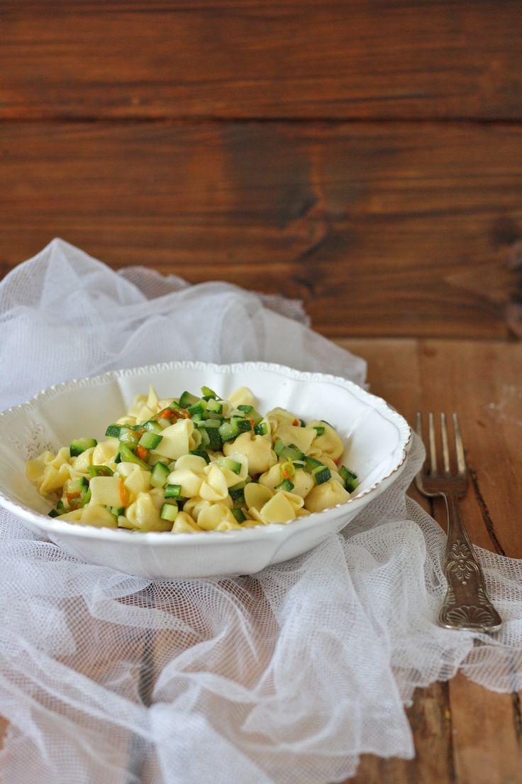 PARMISAN PERLINE WITH COURGETTES, ZUCCHINI FLOWERS AND ROASTED PINE NUTS. Recipe: http://www.loscoiattolo.it/en/perline-al-parmigiano-reggiano-con-zucchine-fiori-di-zucchina-e-pinoli-tostati/