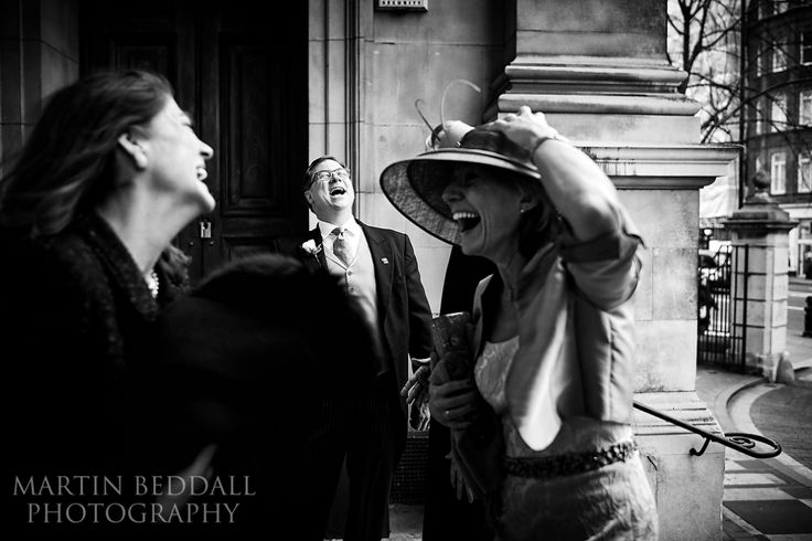 laughing bridal party on church steps