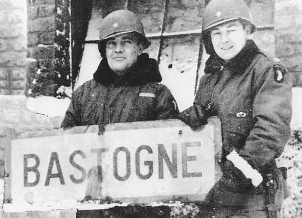Brigadier General Anthony McAuliffe and Lieutenant Colonel Harry Kinnard II at Bastogne Belgium late December 1944.