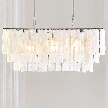"""Large Rectangle Hanging Capiz Pendant Tiers of shimmering natural capiz shells—often referred to as """"glass oysters"""" because of their fragile, translucent appearance—are hand cut and hand strung by talented Filipino artisans to create this piece, which casts a beautifully luminous glow over a dining table. - White on westelm.com"""