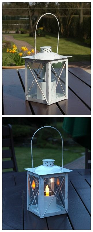 White metal #solar #lantern. This looks great in the day with it's #shabbychic design and fab at night with a bright flickering #amber LED #candle. Great for #bbq season!