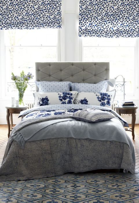 Transform a neutral bedstead with a floral duvet and pillowcases. Finish with a wool throw in a paler sky hue for an elegant look. To make your room feel larger and brighter, paint the walls in a chalky off-white or pale shade of blue. For a more dramatic statement try a darker backdrop, which will look gorgeous with bright white and inky blue linens.