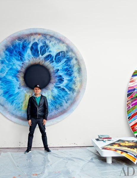 MARC QUINN Artist Marc Quinn stands before his 2011 painting We Share Our Chemistry with the Stars (CS 300R). For details see May Sources.