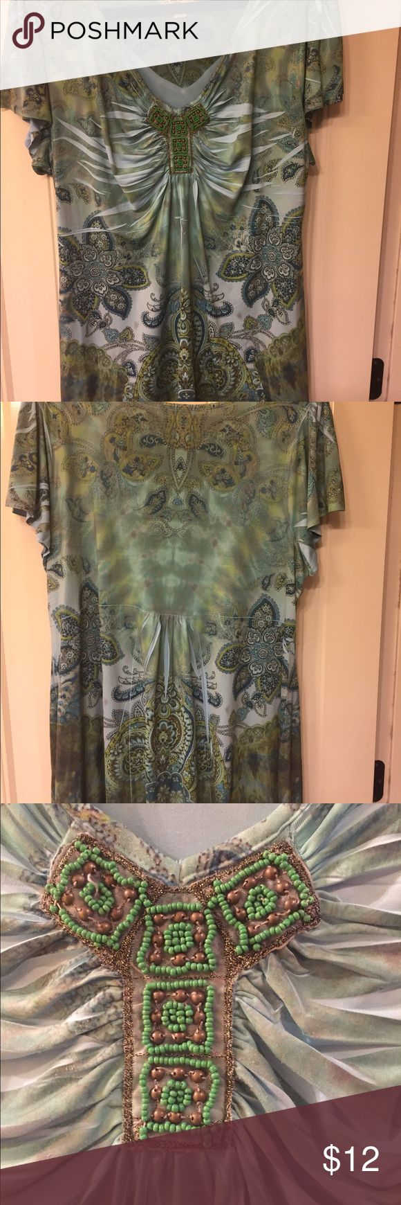 Short sleeve top Cute light blue and green short sleeve tunic top.  Perfect casual top for jeans. EUC live and let live Tops Tunics