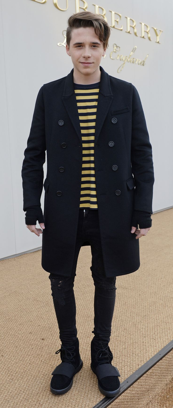 Brooklyn Beckham wearing a Burberry T-shirt and outerwear to arrive at the Menswear January 2016 show