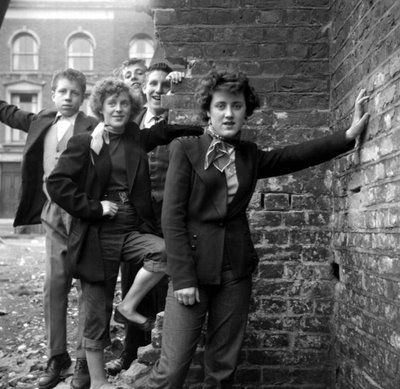 """'Ken Russel's series of documentary """"Teddy Girl"""" photographs were published in Picture Post magazine in the summer of 1955′    - Wikipedia"""