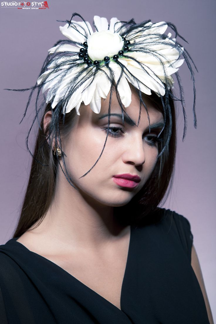 La taranta- white flower with black feathers and pearls