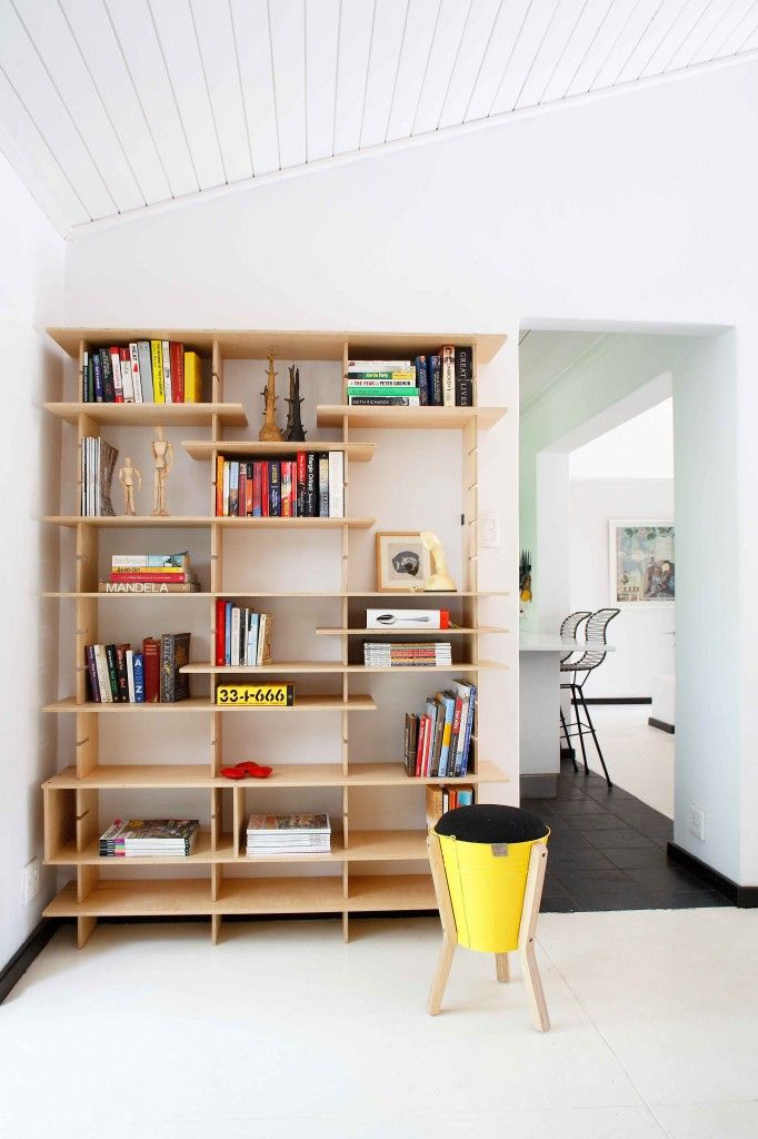 Flexible shelving solution by Pedersen+Lennard. Birch plywood and textured black mild steel fixings were used to expose how the shelf is fastened. The unit fades in comparison to what is being exhibited.