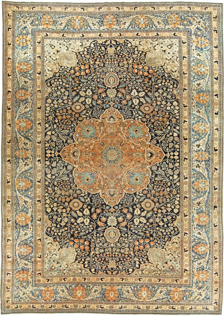 An early 20th century Persian Kashan carpet, the blue field with an allover trellis of palmettes, leafy vinery and central medallion within an unusual Light blue  border with leaves and floral motifs.