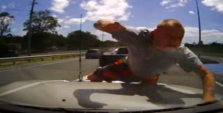 The road rage attacker who was caught on a dashboard camera smashing the windscreen of a former police officer was sentenced to two years' probation and six months' licence suspension.