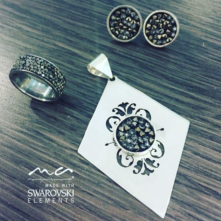 Aretes y dije en plata con cristales de Swarovski hechos a mano y anillo en acero