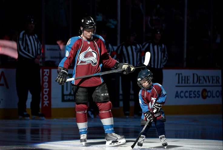 Description of . DENVER, CO - March 4: Colorado Avalanche left wing Alex Tanguay (40) stands on the ice with his son, Samuel, during a ceremony celebrating his 1,000 game Wednesday, March 4, 2015 at the Pepsi Center in Denver, Colorado. (Photo By Brent Lewis/The Denver Post)
