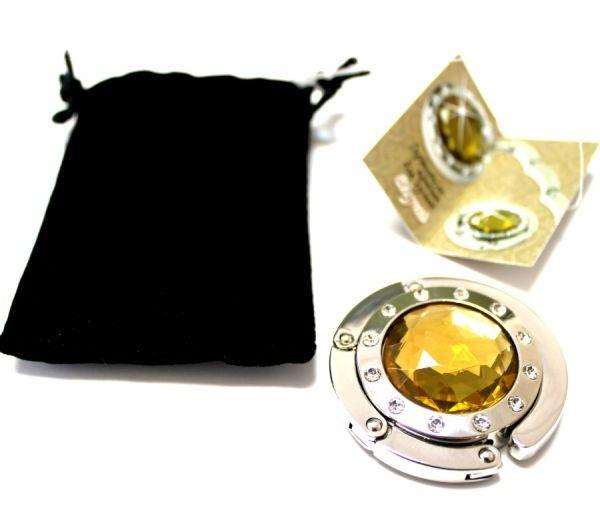 Держатель-крючок для сумки надежно фиксируется на любой поверхнос