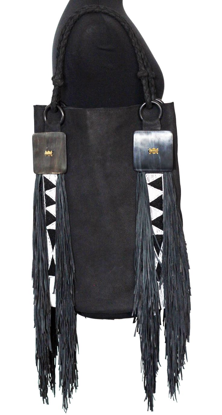 Lana Fringe Bag in black suede with cow horn and brass embellishments. Black suede fringing. We Deliver Worldwide. Order now by writing to us on Facebook or e-mailing mailto:sales@annatrzebinski.com  For further information about our products, studio and upcoming trunk shows please feel free to contact us.