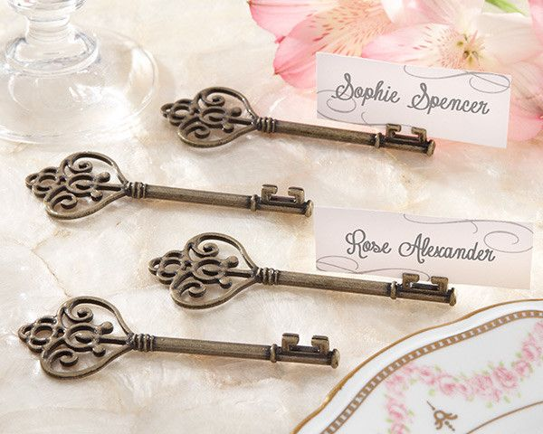 Vintage charm meets utterly unique in Kate Aspen's Victorian key that holds place cards and photos. A fabulous favor is the key to a memorable thank-you gift, a