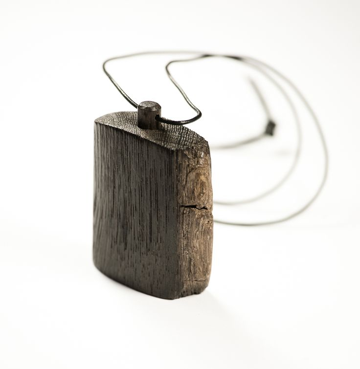 Pendant made of construction wood from the buildings of the Old Town of Gdansk. Black oak dating back to the 14th century. Each copy is absolutely unique.
