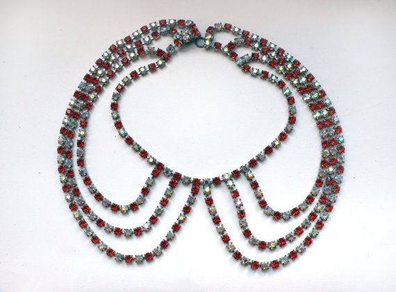 1960s Statement necklace made in a collar shape symetrical design of three graduated rows of high quality red safran and jonquil aurora borealis