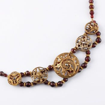 """Marchesa Necklace    The Marchesa necklace has five buttons linked together with two rows of crystal and metal accents. Usually the center button is large and dramatic with four smaller buttons accenting the large one. The length of the necklaces are 16"""" with a 1"""" chain extension. Marchesa necklace prices start at $326."""