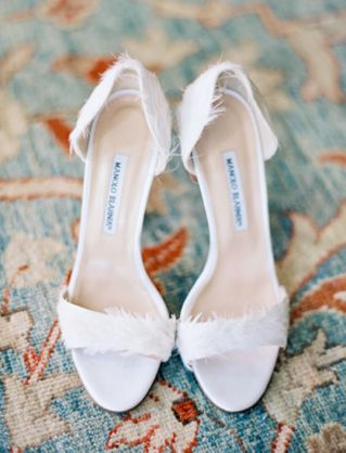 Feathered Manolo Blahnik bridal shoes | see more on: http://burnettsboards.com/2014/03/burnt-orange-white/