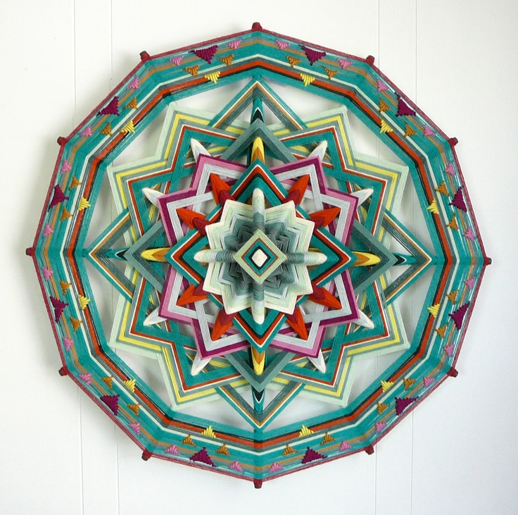 ojo de dios - means 'eye of god'.