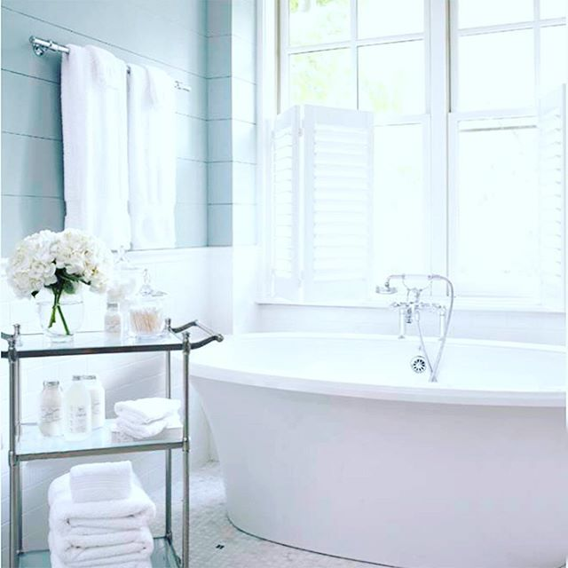 { S O A K }  The perfect spot for a Sunday Bubble Bath!  Love the shiplap panelling and white subway tiles all designed by the talented #lindamcdougalddesign.  Check out Linda's blog @postcardfromparishome - For a similar colour here in Australia try @duluxaus #Dewpoint - just gorgeous #interiordesign #shiplap #bathroomdesign #hydrangea #interiors #frenchdressing #french_dressing_furniture #sundaysoak #subwaytiles
