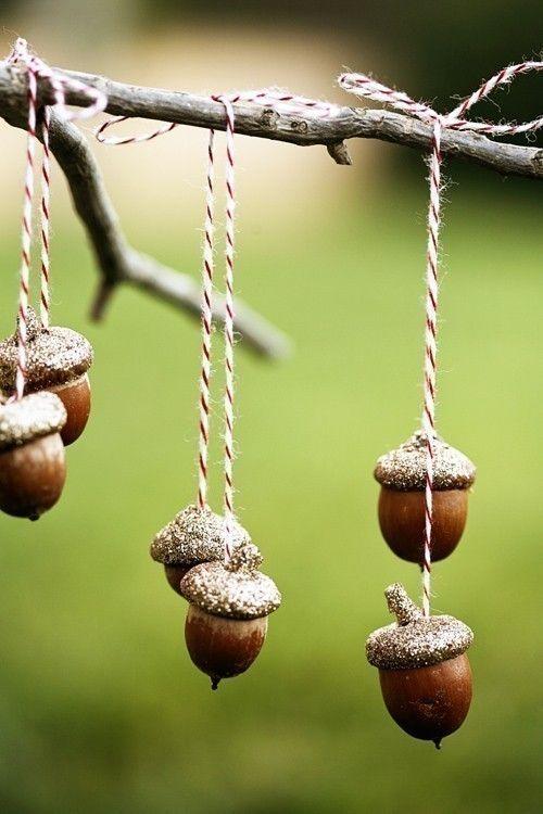 3 sets of golden acorns . ornaments. via Etsy.