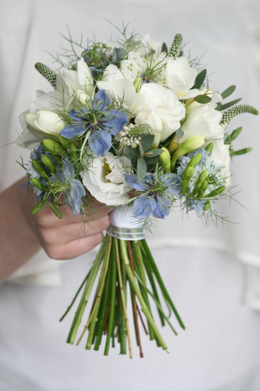 Blue Nigella bouquet with white freesia and white Veronica, white lisianthus