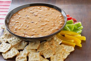 Velveeta chili cheese dip-16 oz Velveeta, 1-15 oz can chili, with or without beans. Super easy and delicious. I serve with tortilla chips.