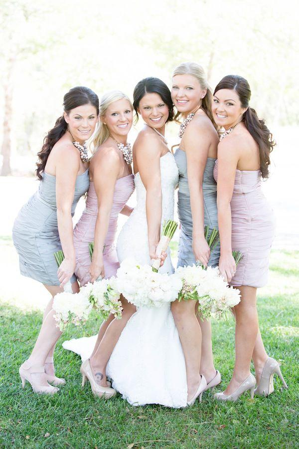 grey and pink bridesmaid dresses http://www.weddingchicks.com/2013/10/03/vintage-outdoor-wedding/
