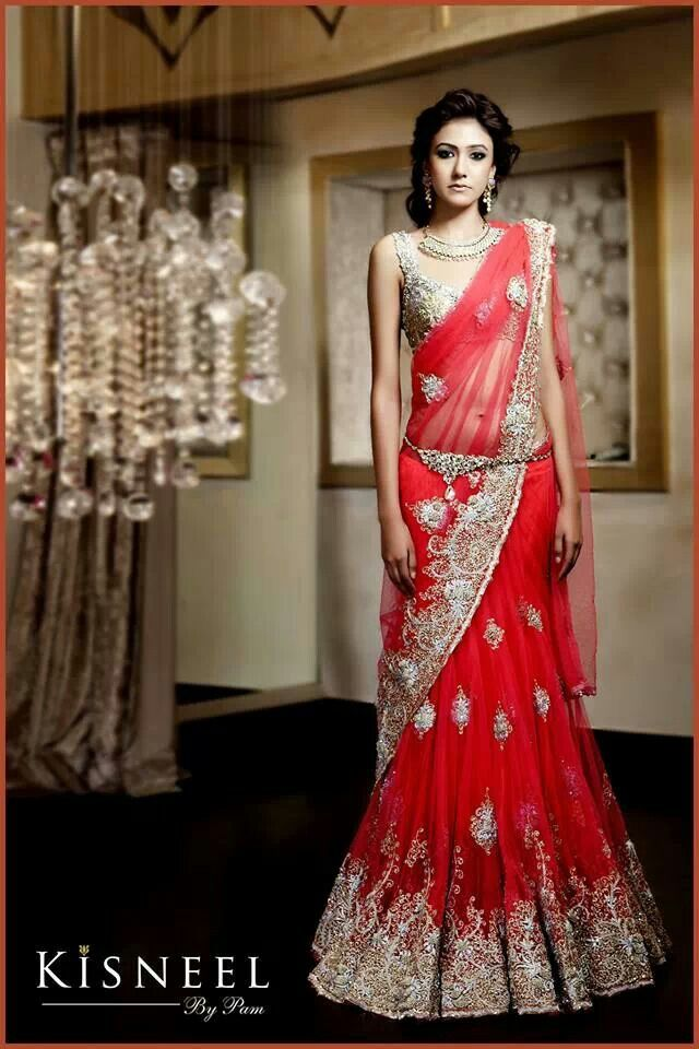 Imagine royal blue instead of the reddish-pink and a ready-made saree style instead of the lengha flare? Short sleeves would complete this outfit