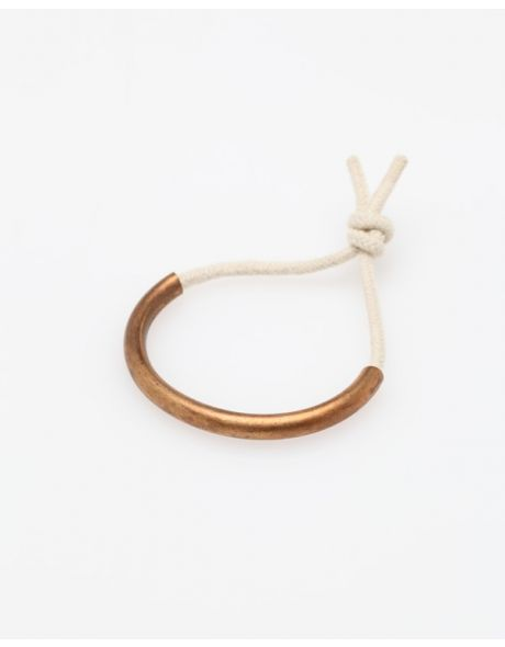 "The Copper Age Bracelet in White ::  Chunky bracelet from Maslo Jewelry, with copper tube on a knotted rope.    Handmade in USA    Approximately 3"" diameter"