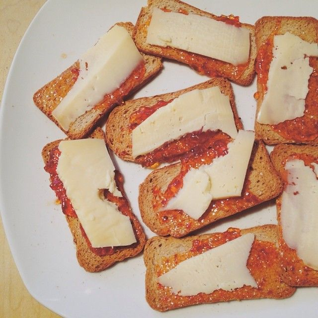 Yummy snack of Melba toast topped with red pepper jelly and a slice of Big Brother cheese from Glengarry Fine Cheese in Ontario!  I've got a few recipes coming up featuring more cheese from the Dairy Farmers of Canada. #simplepleasures #cdncheese #sponsored