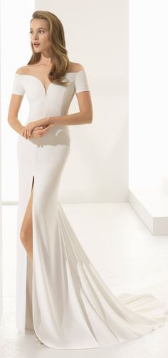 Perfect for sophisticated, modern brides! PADUA by from @rosaclara 2018 couture collection. That thigh high slit is everything! #gownoftheweek #rosaclara #rosaclara2018 #wedding #weddingdress #ad #weddinggown