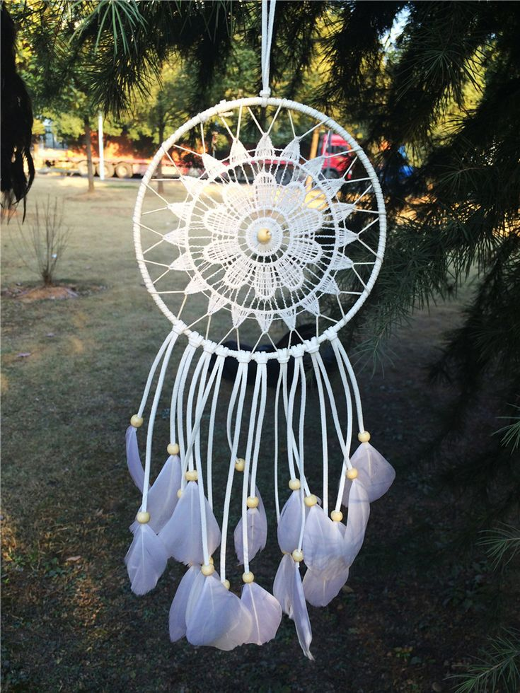 Crocheted dream catcher (white) with feathers.