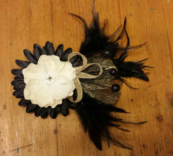 Black and Ivory fascinator with burlap ribbon accents. This piece is truly stunning. Perfect for any formal occasion. Measures roughly 8 at widest