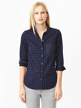 Love the small Polka dots and the contrasting pocket and cuffs.  Wish it were a more vibrant color, navy doesn't do much for me. Also wish it were a bit more fitted to a woman's shape.