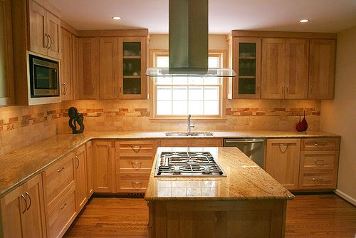 Maple Cabinets And A Travertine Backsplash Bring Natural Elements To This Kitchen Complete With